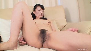 Skinny Japanese mature Kiyoe Majima gets her pussy fingered