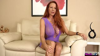 Ample breasted mature red supporter Faye Rampton is toying her insatiable grab
