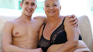 Fat grandma's chest covered with jizz