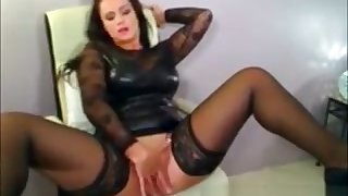 Sexy Brunette Milf In Latex Fingers pussy