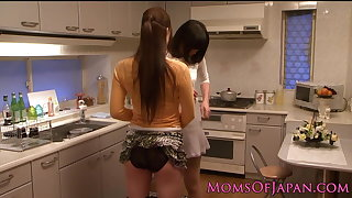 Japanese mature receives oral from pet in kitchen
