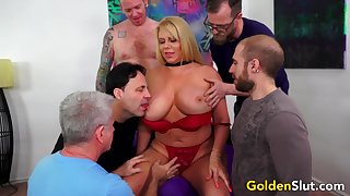 Busty Older Karen Fisher Gets Gangbanged