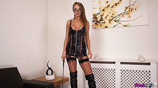Strict mistress in latex corset and stockings Mia wants to whip someone