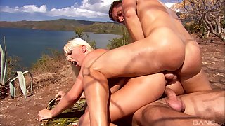 Diana Gold is between her handsome loveres during a threesome