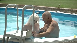 Pale charming chick with small tits Miss Melissa rides older neighbor on top