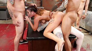 Chained up brunette Kendra Heart used as a sex slave by three men